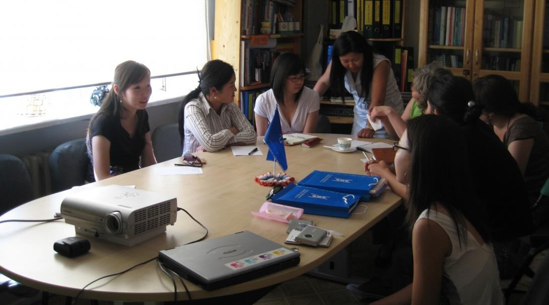 Local cases are discussed in a meeting as part of a Human Rights internship in Mongolia.
